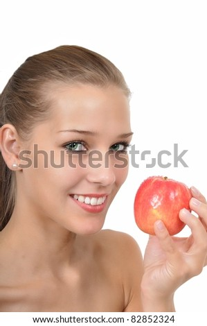 Sexy young woman with green eyes holding an apple - stock photo