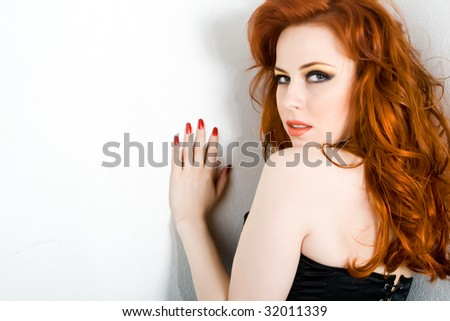 Sexy young woman with long red hair - stock photo