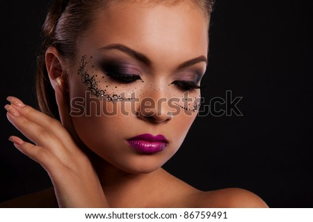 sexy young woman with mask on face and magnificent violet lips