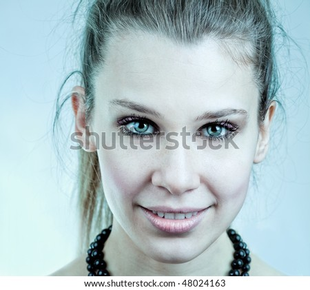 Sexy young woman with nice blue eyes - stock photo