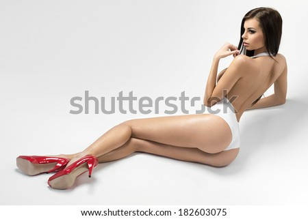 Sexy young woman with perfect body - stock photo