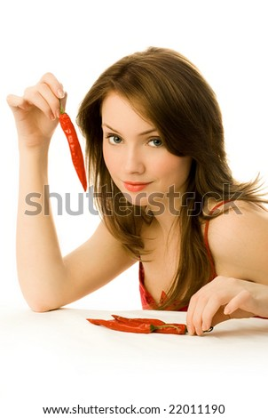 sexy young woman with red chili peppers isolated against white background