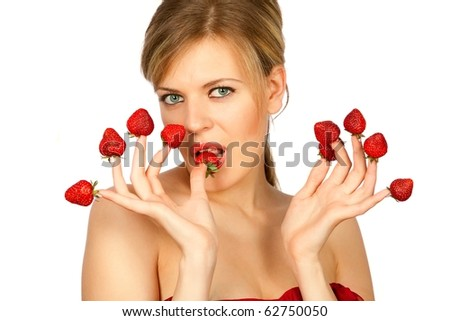 Sexy young woman with red strawberries picked on fingertips isolated on white background - stock photo