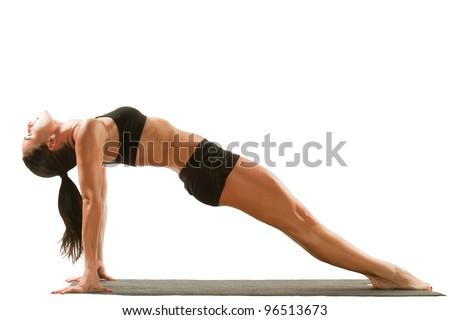 Sexy young yoga female doing yogic exercise on isolated white background - stock photo