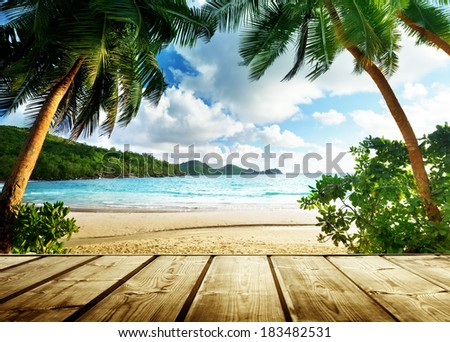 seychelles beach and wooden pier - stock photo