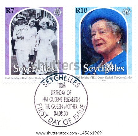 SEYCHELLES - CIRCA 2000: A stamp printed in Seychelles, shows portraits of Queen Elizabeth II, circa 2000 - stock photo