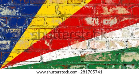 Seychelles flag painted on old brick wall texture background - stock photo