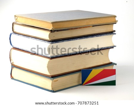Seychelles flag with pile of books isolated on white background