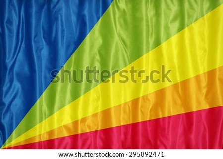Seychelles-ized Gay Pride flag pattern on fabric texture,retro vintage style