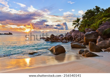 Seychelles tropical beach at sunset - nature background - stock photo