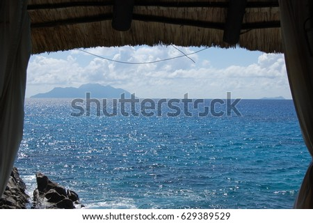 Seychelles view of the Indian ocean with Praslin island in the background, taken on Mahe island