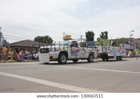 SEYMOUR, WI - AUGUST 4:  Seymour Scouts Colorful Truck Pulling Float at the Annual Hamburger Festival Parade on August 4, 2012 in Seymour, Wisconsin.