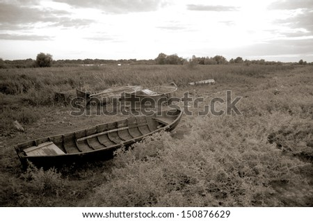 Sfantu Gheorghe, Romania - old fishing boats in reed - stock photo