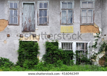Shabby abandoned building in Bulgarian village - stock photo