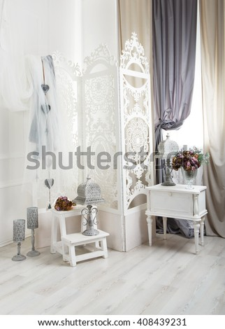 shabby chic room interior. Wedding decor, room decorated for shabby chic rustic wedding, with bedside table, folding screen or room divider with white tracery and rose bouquets. High key - stock photo