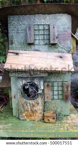 shabby chic rustic wooden bird house - stock photo