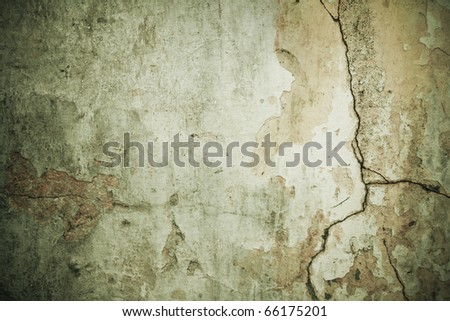 Shabby cracked wall green grunge background with dark borders - stock photo