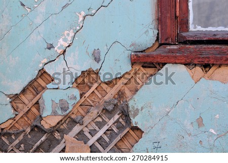 Shabby grungy wall of the old house - stock photo