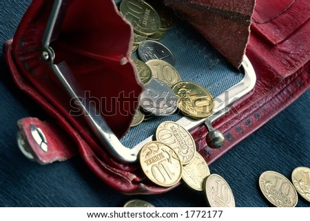 Shabby purse with last coins