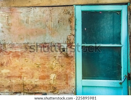 shabby wall with a door - stock photo