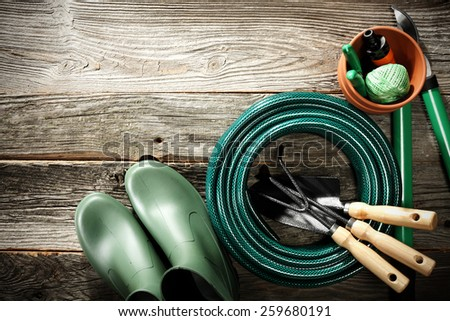 shabby wooden terrace floor and tools  - stock photo