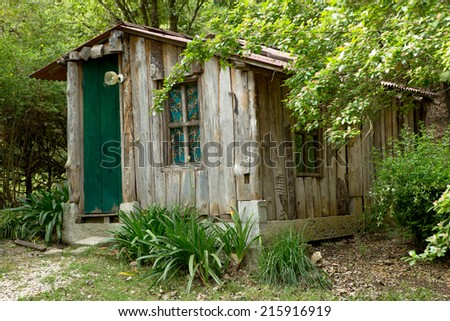 shack built from rough wood planks in the forest  - stock photo