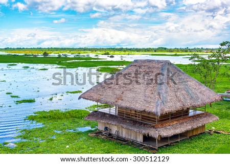 Shack floating on a river in Iquitos, Peru - stock photo