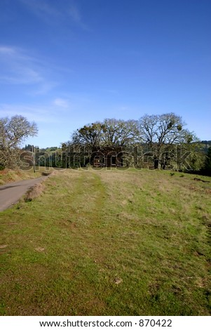 Shack on one lane road in Sonoma ranch country. - stock photo