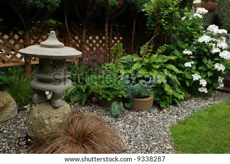Shade Garden with green plants and Japanese gazebo