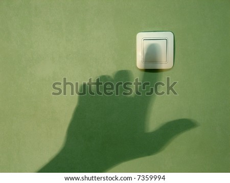 Shadow by hand on a wall - stock photo