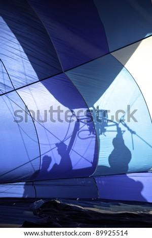 Shadow inside blue balloon - stock photo