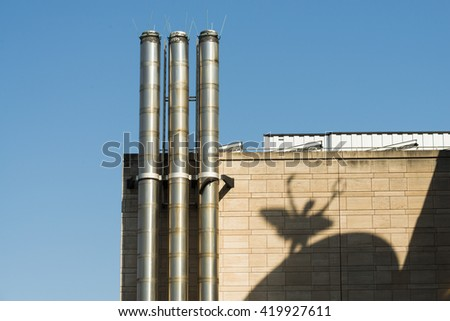 Shadow of a figure on a facade - stock photo