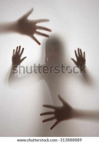 shadow of a girl behind transparent paper