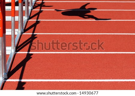 Shadow of a Hurdler jumping, during a race - stock photo