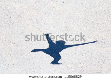 shadow of a man jumping on the asphalt