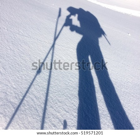 shadow of a man silhouette on the snow
