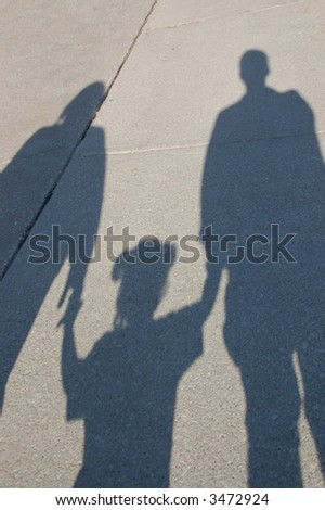 Shadow of a young family.  Mother, toddler and father.