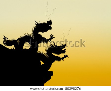 shadow of chinese dragon eaves with golden background - stock photo