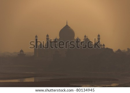 Shadow of edifice looms over the Yumana river as seen from Agra city. - stock photo