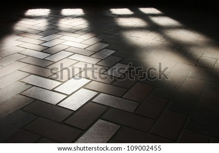 shadow of glass door on pavement. - stock photo