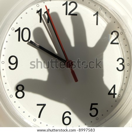 shadow of hand on the clock