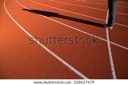 Shadow of man standing and waiting on track. Waiting for a new start or beginning. - stock photo