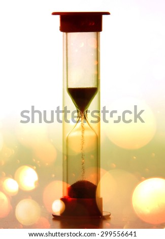 Shadow of sand that were leaked by the fall of an hourglass.with bokeh in sepia tone . - stock photo