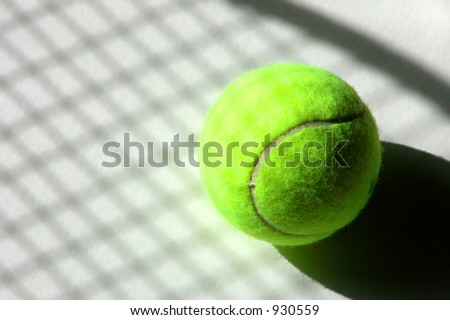 Shadow of tennis racket and strings on a ball