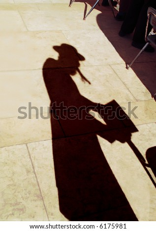 Shadow of the israelite of that being praying in western wall. - stock photo