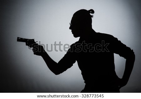 Shadow of the man with gun - stock photo