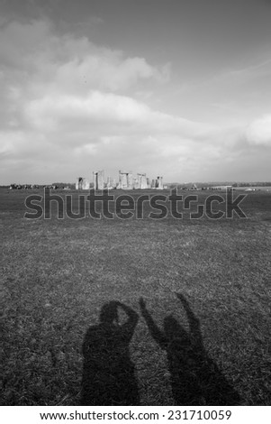 Shadow of tourists at Stonehenge, England. - stock photo