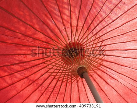 Shadow on a red umbrella - stock photo
