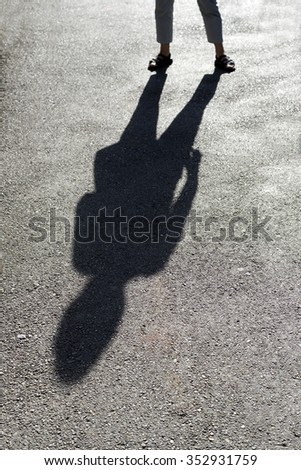 Shadow on the pavement - stock photo