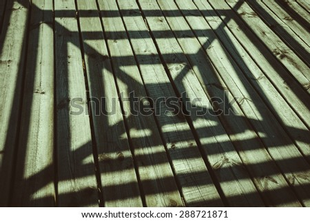 shadow on the terrace, wood texture in architecture - stock photo
